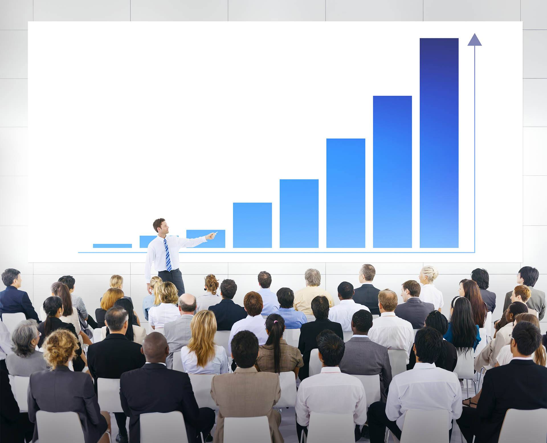 Crowded presentation in large conference meeting room